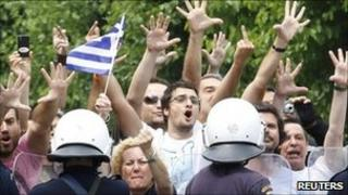 Demonstrators confront riot police near the Greek parliament in Athens, 15 June 2011