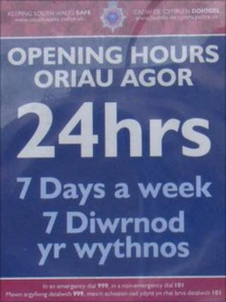 Notice on entrance at Swansea Central Police Station