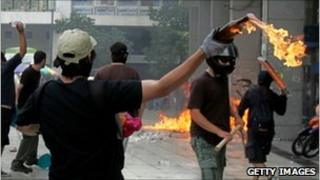 Greek rioters with petrol bombs