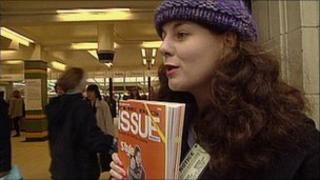 Homeless woman selling Big Issue