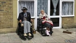 Residents sit outside a Southern Cross care home