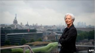 Christine Lagarde poses on the roof of her office
