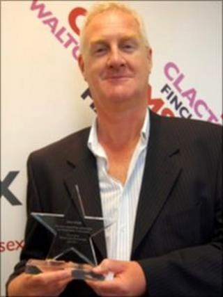 BBC Essex presenter Dave Monk with his award from the North Essex Partnership NHS Foundation Trust