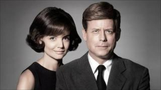 Katie Holmes and Greg Kinnear as Jackie and John F Kennedy