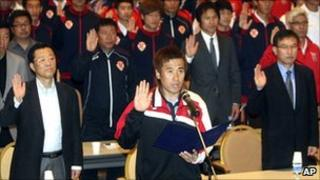 South Korean K-League Gyeongnam FC goalkeeper Kim Byung-ji, front, takes an oath with other players, coaches and referees, to end match fixing during a workshop in Pyeongchang, South Korea.
