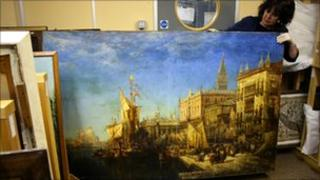 Maria Killoran from Leek's Nicholson Institute holds the Venice painting