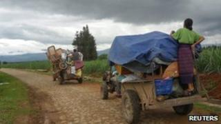 Kachin people fleeing fighting near the Chinese border, Burma