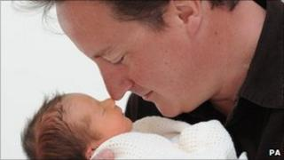 David Cameron with his new born daughter Florence