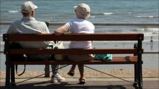 Elderly couple by a beach