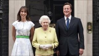 Queen Elizabeth poses with Prime Minister David Cameron and his wife Samantha