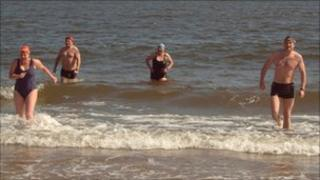Swimmers walking out of the North Sea