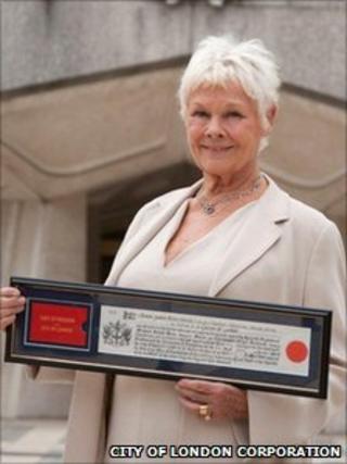 Dame Judi Dench collecting her award