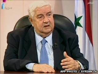 Syrian Foreign Minister Walid Muallem appears on state TV