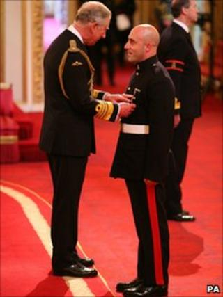 Corporal James Bedford is decorated with the Military Cross by the Prince of Wales