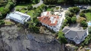 A file photo taken on February 27, 2011 shows luxury houses teetering on the edge after landslides in Red cliffs near Christchurch following a 6.3 earthquake that devastated New Zealand second city and surrounding towns killing 181 people on February 22