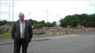 Head teacher standing in front of the land proposed for the KFC restaurant