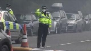 Police woman in mask directing traffic