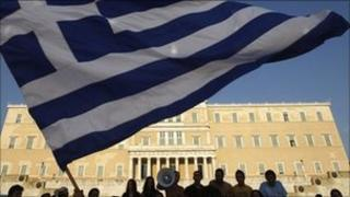 Protesters wave a Greek flag in Athens (17 June 2011)