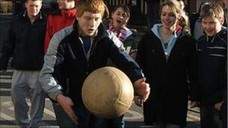 Man with a ball during the Atherstone Ball Game