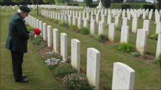 Alf Arnold lays poppies in Northern France