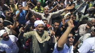Egyptians chant slogans as they attend the weekly Friday protest in Tahrir Square in Cairo, Egypt, on 17 June