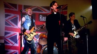 The Reverend Phil Chew on stage with his punk band Revisit