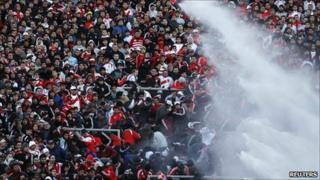Police used water cannon to disperse River Plate fans at the end of the match against Belgrano in Buenos Aires (26 June 2011)