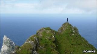 Survey team member on Mullach an Eilein, the highest point on Boreray. Image: RCAHMS