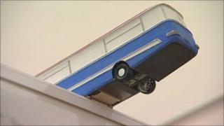 A maquette of a bus sculpture