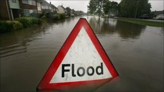 A flood sign in a street during floods in 2007