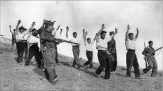 Soldiers of Gen Franco's Nationalists escort captured Republican troops in the Spanish Civil War