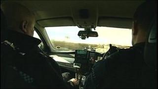 Police officers in car