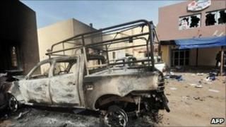 Courtyard of a branch of Senegal's state electricity company Senelec in Dakar's suburb la Patte d'Oie with the wreckage of a vehicle set on fire during a demonstration to protest against power cuts on Monday 27 June