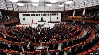 Turkish MPs stand for the national anthem during the swearing-in ceremony in the Turkish parliament in Ankara, 28 June