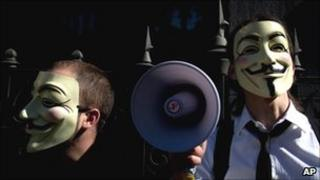 People wearing masks often used by a hacker group that called Anonymous