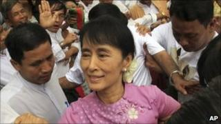 Aung San Suu Kyi is mobbed by supporters as she arrives at her National League for Democracy party headquarters in Rangoon