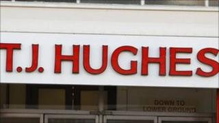 TJ Hughes sign