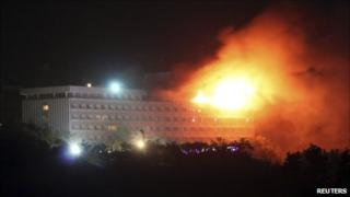 Smoke and flames rise from the Intercontinental hotel during a battle between NATO-led forces and suicide bombers and Taliban insurgents in Kabul June 29, 2011