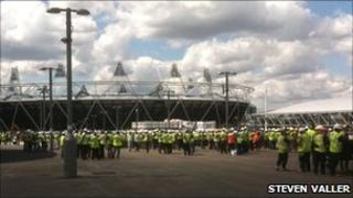 Workers observe silence at the Olympic Park site