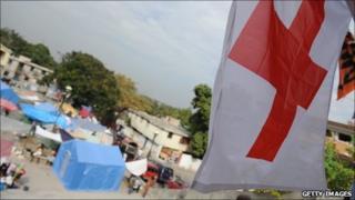 A Red Cross flag flies in Haiti