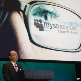 Rupert Murdoch speaks in front of the MySpace logo