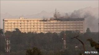Smoke billows from the Intercontinental hotel during a battle between Afghan security forces and suicide bombers and Taliban insurgents in Kabul June 29, 2011.