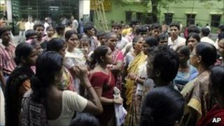 Relatives and parents gather outside the BC Roy Hospital for Children in Calcutta in June 2011 to protest against infant deaths