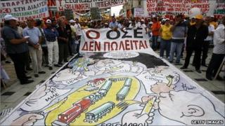 Protesters holding a giant painting of a train
