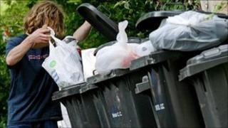Man throws away rubbish in Bristol
