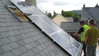 Solar panels being fitted to a home