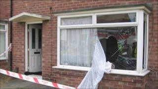The house where an elderly woman was seriously hurt in a suspected gas explosion