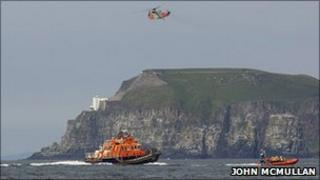 RNLI boats were launched from Portrush and Redbay, along with a helicopter from Scotland