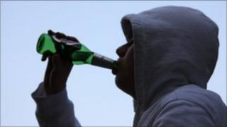 A teenager drinking alcohol
