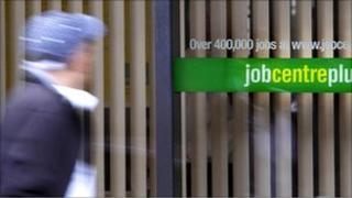 Youth walking past Job Centre Plus sign
